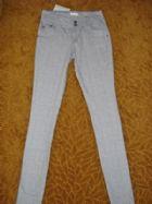 โพรโม้ด กางเกงขายาวสีเทาลายตารางเส้นสีขาว Abstract Square Print Jeans  size 4