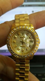 นาฬิกา Ladies เรือนทอง ระบบ Autometic Day-Date Ladies with Yellow Gold Watch หน้าปัดวงกลมล้อมเพชร