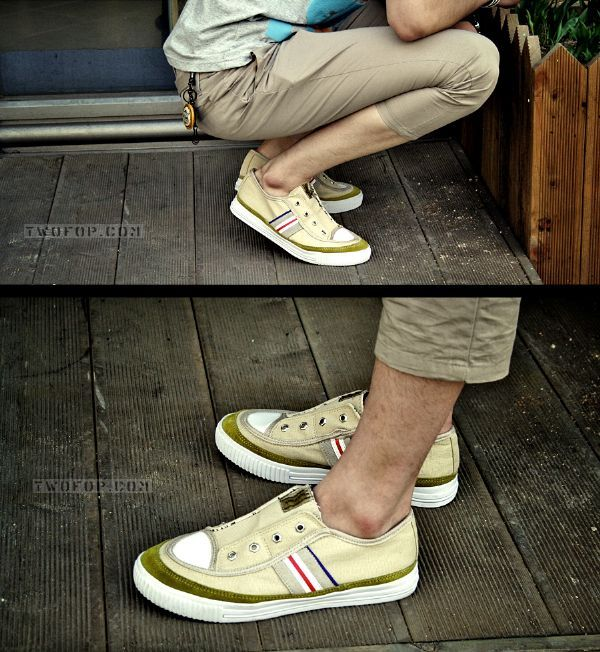 เสื้อผ้าผู้ชาย : กางเกงสามส่วนสีกากีติดกระดุมตะโพก