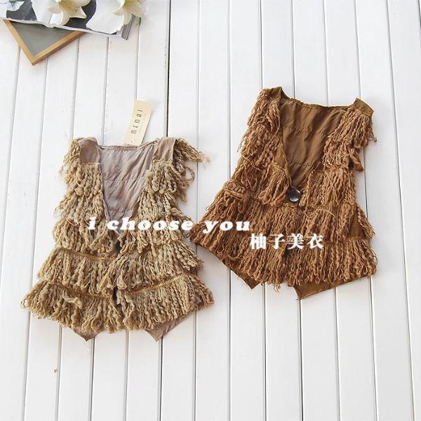 เสื้อผ้าแฟชั่น: เสื้อกั๊กแต่งพู่สไตล์ chic and hip