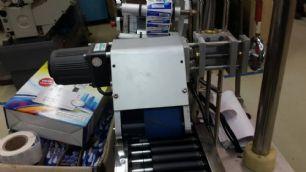 เครื่องติด Sticker บนผลิตภัณฑ์