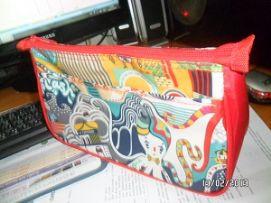 กระเป๋าเครื่องสำอางค์ทรงมน ผ้าลิปสต๊อปพิมพ์ลาย